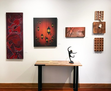 Gretchen Olberding (sculpture), Larry Schwisow (cutting boards and table), Alias Kane (paintings)